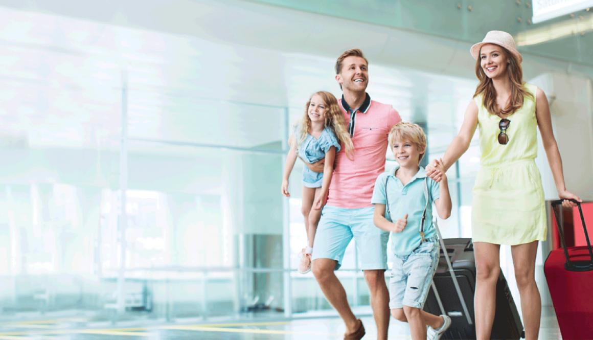 Family walking in airport terminal